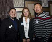 Sacramento Business Journal audience development executive Arthur Rangel, Kelly Teagh of US Bank and Kao Saephanh of SAFE Credit Union pose at the Alliance holiday mixer.