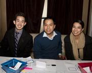 Asian Chamber staff Matt Sumida, John Nguyen and Alisa Alcantar pose at the Alliance holiday mixer.