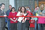 Adoption Star founder and CEO Michele Fried cuts the ribbon in front of new offices on John Muir Drive, Amherst, in March.