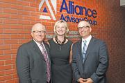 Alliance Advisory Group CEO Robert Fashano, left, CFO Barbara O'Neill and President James Fashano in the lobby of the headquarters at 600 Delaware Ave., Buffalo.