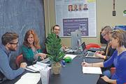 Staff of The Mac Groups work on creative concepts for a client.