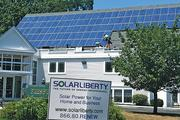 Peter Carcione of Solar Liberty Energy Systems Inc. installs a 24.36 kW (116 solar panels) solar array at First Presbyterian Church in Youngstown.