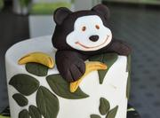 A fondant monkey with a banana adds a decorative feature to this cake.