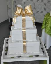 A tiered present-themed cake.