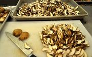 Nearly 200 mushrooms that I sliced.