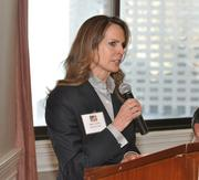 Holland & Knight partner Maria T. Currier makes opening remarks before the panel.