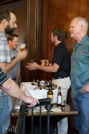 Steve Kurowski, marketing director for the Colorado Brewers Guild, talks with Doug Odell, co-owner of Odell Brewing Co. of Fort Collins at a Vail Cacade Brewmaster's Weekend tasting in August 2012.
