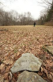 A sample grave marker, made from a stone pulled from a nearby creek, sits on display with others at Penn Forest Natural Burial Park in Penn Hills. The 32-acre burial ground is the only exclusively green cemetery in Pennsylvania.