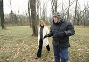 Penn Forest Natural Burial Park manager Pete McQuilin and visitor Wendy Long chat while walking in the Meadow in the Woods section of the 32-acre green cemetery in Penn Hills. Sequential lots, in which the cemetery decides the location, are priced at $1,800 each. Select lots, which are sites picked by the customer, sell for $2,200 each.