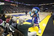 The team's mascot, Globie, interacts with fans.