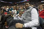 P.J. Brown of the US Army and Ophelia Miller of Aurora Health Care watch the show with their sons.