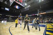Many fans sitting courtside got to participate in on-court activities with the Globetrotters.
