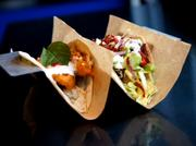 Velvet Taco's menu includes the crisp tikka chicken, which features spicy pepper sauce and basmati rice, and the roti chicken bit, which features goat cheese and duck bacon.