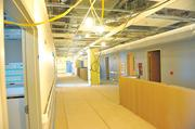 At Kaiser's new hospital: Plenty of overhead space for wires, technology, and an open layout of nurses' stations.