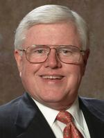 <strong>Holcom</strong> retires as CEO of Pioneer Financial Services