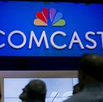 Comcast shareholders OK merger with Time Warner Cable