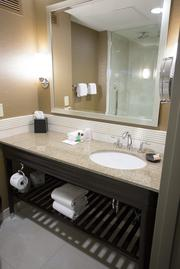Bathroom upgrades include removing bathtubs and installing ceiling-affixed rain showerheads.