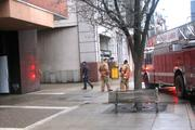 The leaking water seemed to be coming from the rear of the building, near loading docks,