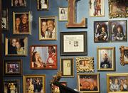 A wall in Lannie's Clocktower Cabaret displays the many faces, and celebrity acquaintances, of entertainer Lannie Garrett.