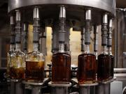 Bottles of Knob Creek single barrel bourbon are filled on the bottling line at the Beam Inc. distillery in Clermont, Ky.