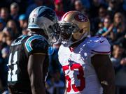 Carolina Panthers wide receiver Brandon LaFell and San Francisco 49ers linebacker NaVorro Bowman get chippy with one another. The 49ers beat the Panthers 23-10 in the divisional playoff game Sunday at Bank of America Stadium.