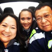 """This is a family """"selfie"""" with Lorna Kneeland on left, sister Christina Quinn in middle, and father Neil Quinn on right. Neil Quinn, former head engineer of the Washington State Ferry System, has held Seahawks season tickets since the team's first year. He has been taking his girls since they were 6."""