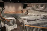 Dust tarps cover the seats in the almost-finished Harry T. WIlks Theater.