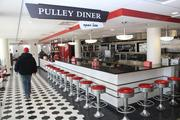 Workers get ready to open the Pulley Diner, which will serve food to students late into the night.
