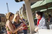 Guests enjoy the La Vie Rose Frozen Slush and Tarte a la Ratatouille at the L'Orangerie marketplace near the France pavilion.