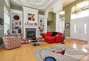 1102 Highgate Drive: The great room has hardwood floors and 18-foot ceilings.