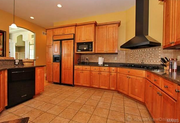 1102 Highgate Drive: The kitchen has maple cabinets, granite countertops and a breakfast bar.