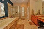1102 Highgate Drive: The master bathroom has a jet tub.
