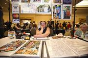 Artist David K. Wong from Brick by Brick displays some of his work at the Dealers Den, where furries can buy original pieces from vendors.