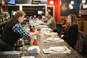Not Your Average Joe's bartender Robyn Pitchford serves Mackenzie Bigelow in the Arlington, Mass. restaurant.