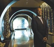One Ocean Resort Divisional Vice President Sileshi Mengiste at the entrance to the resort's restaurant Azurea.Both made AAA's Four Diamond list for 2014.