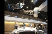 Massive jet engines that showcase the company's history hang from the ceiling of the center.