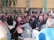 The seating area was packed as many people stood in a standing-room-only area in the back of the room.