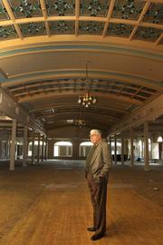"""Inside the grand ballroom, Belleair Mayor Gary Katica remembers parties and lavish affairs that were like none he's seen since. The stained glass is the last of the hotel that remains mostly unbroken. """"Every time I come in the hotel I relive wonderful memories. It makes me sick to see it like this."""""""