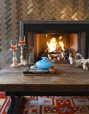 Clarissa Hulsey Bailey brings a touch of the exotic to her interior designs. She has, after all, lived in such vivid surroundings as Marrakesh, Morocco. The cozy ambiance in this fireplace nook will be showcased in the interiors at 1820 Spillman Road. Bailey handles both residential and commercial design, including the SXSW headquarters.