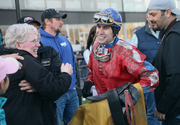 Portland Meadows Oregon Derby winning Jockey J. Luis Torres is greeted with smiles from owners and trainers.