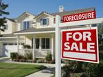 Despite some positive signs, residential foreclosures still plague region