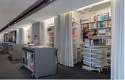 "Idea gallery: The Gensler product library is kept behind drapes and project ""scrum bars."""