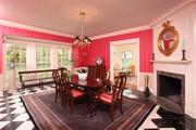 The dining room has marble floors, a wood-burning fireplace, lighted china cabinet and deep double-hung windows.