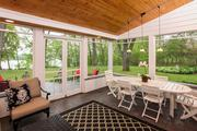 The home has a screened porch with a paver floor.