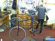 The mechanic from Coxsackie Bike and Sport at work. For the record, my bike's steel frame makes it ideal for commuting and long-distance touring rides. It isn't exactly ideal for racing, one more factor that made me an outsider at Saturday's race.