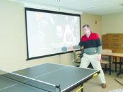 Employees play pingpong in the office of Dixon Hughes Goodman.