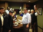 """""""Employees of Cory Watson Crowder & DeGaris, a law firm on 22nd Street South and Magnolia. Everybody who works on Birmingham's Southside knows that Jimmy John's always delivers when you're huddled in for a working lunch. So when more than a dozen attorneys and staff were sheltered in place at Cory Watson Crowder & DeGaris, they called Jimmy John's who made their famous bicycle delivery despite the snow. Friends and community make a tough night a lot easier. As today's severe weather unfolded, the law firm also served as a haven for family members and others caught in the cold."""""""