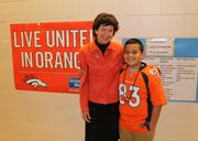 """Mile High United Way, Denver, www.unitedwaydenver.org -- """"Mile High United Way is showing their Broncos spirit by sending a hard-working Denver Public School fourth grader to the Super Bowl. On Thursday, Mario Dominguez was surprised in front of his entire school with an all-expense-paid trip for him and his mom to cheer on the Denver Broncos. Mile High United Way has a rich and longstanding partnership with the Denver Broncos, Denver Public Schools and United Airlines who came together to make this opportunity possible. Pictured: Christine Benero, president and CEO of Mile High United Way and Mario Dominguez."""" -- Jen Morris, Mile High United Way"""