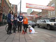 """Dovetail Solutions, Denver, www.dovetailsolutions.com -- """"Our office, located at 14th and Larimer, is full of Broncos pride! We are a dog friendly office and even our dogs are Broncos fans! Jackson (the English Golden Retriever) and Molly (the Cavalier King Charles Spaniel) put this whole thing together, deemed it Broncos day at the office and even found the perfect person to snap our photo! We show our pride each week whether the Broncos win or lose. It is our first topic of conversation each Monday morning in our team meetings. These past two weeks have been very nerve racking and we can't wait to come to the office Monday morning carrying a Broncos win with us against the Seahawks. That win will carry us through the rest of winter and summer and each evening as we look out at the blue and orange sunsets and are beyond grateful for the place we call home. Go Broncos!"""" -- Emily Holleran, Director of Operations"""