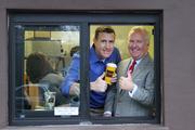 Pitchman Anthony Sullivan and Tampa Mayor Bob Buckhorn surprised customers.